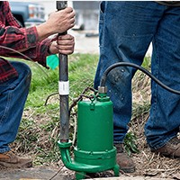 men installing pump
