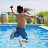boy jumping in pool
