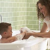 mom and boy in bathtub