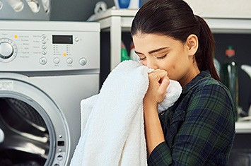 young-woman-laundry-fabric-softener-scent-horizontal-355x235-image