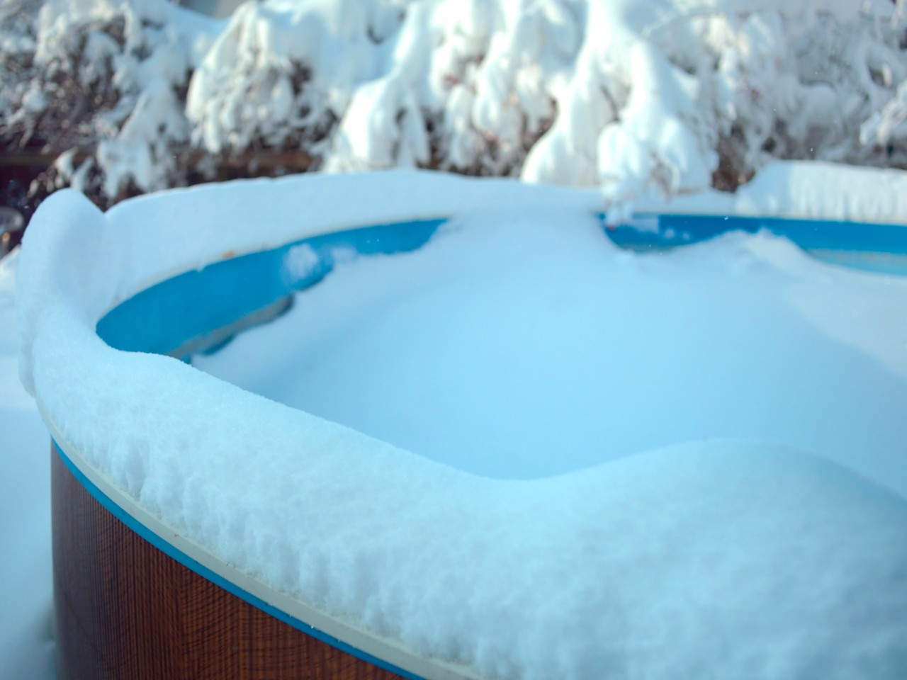 frozen pool covered with snow