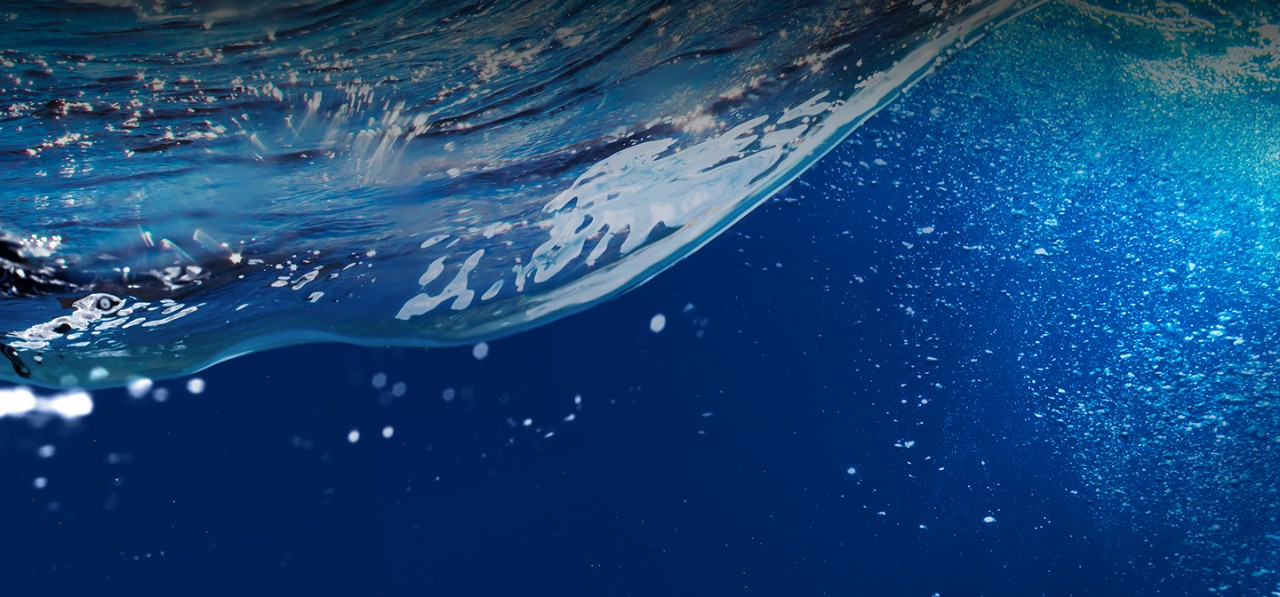 clear-blue-ocean-wave-with-bubbles-cropped-horizontal-1440x672-image-file