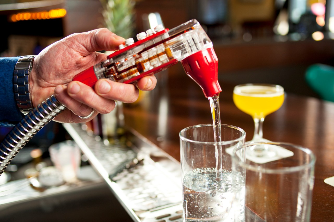 Pouring Drink from Dispenser in a Bar.