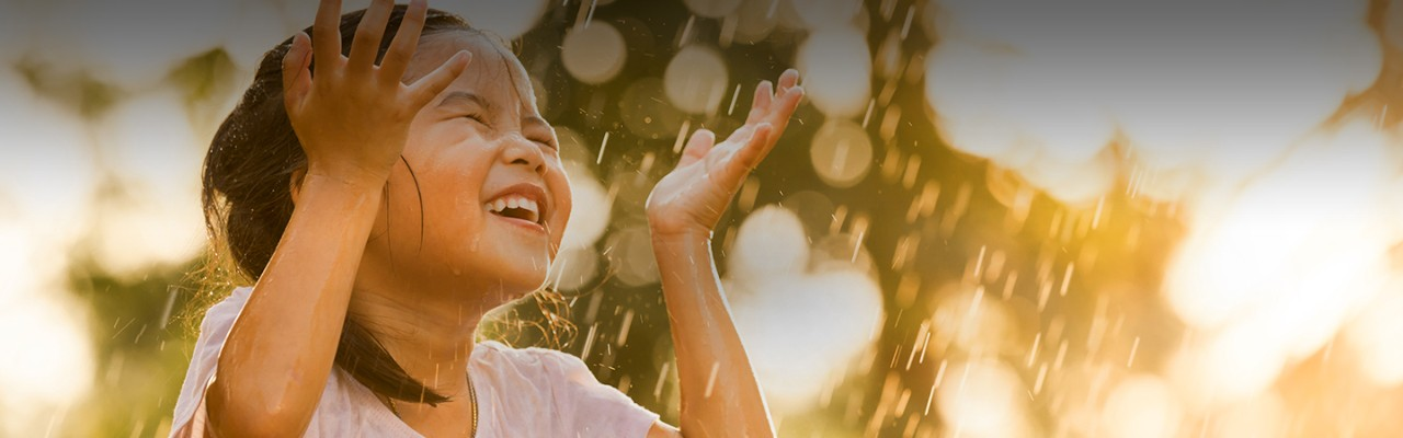 young-girl-dancing-in-rain-water-outdoor-sunny-day-cropped-horizontal-1440x450-image-file