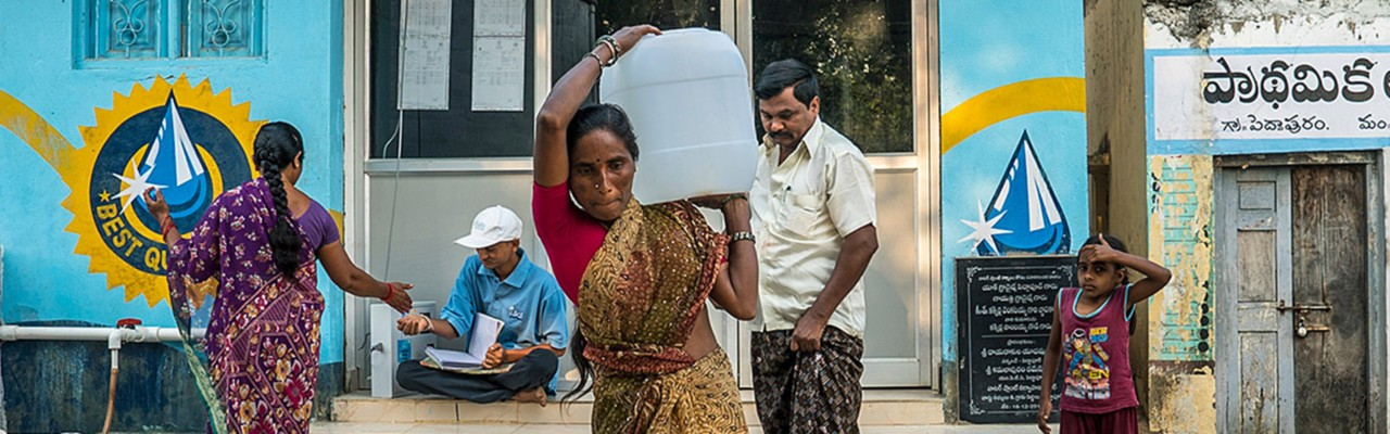 safe-water-network-woman-carrying-water-people-blue-banner-horizontal-1440x450-image-file