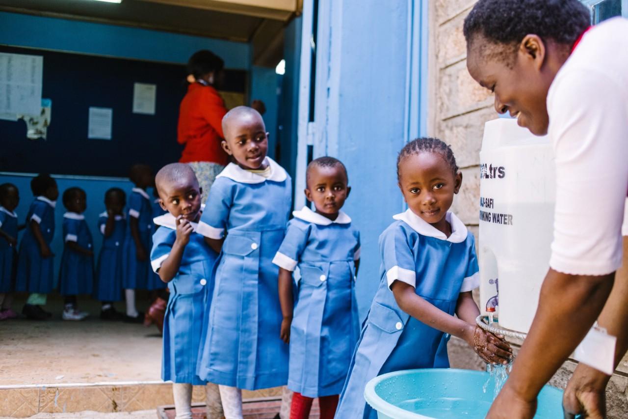 SHOFCO Girls Drinking Water