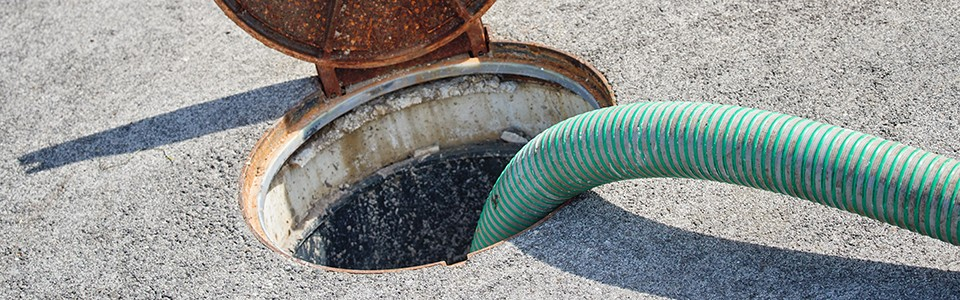 Sewer being pumped with green hose