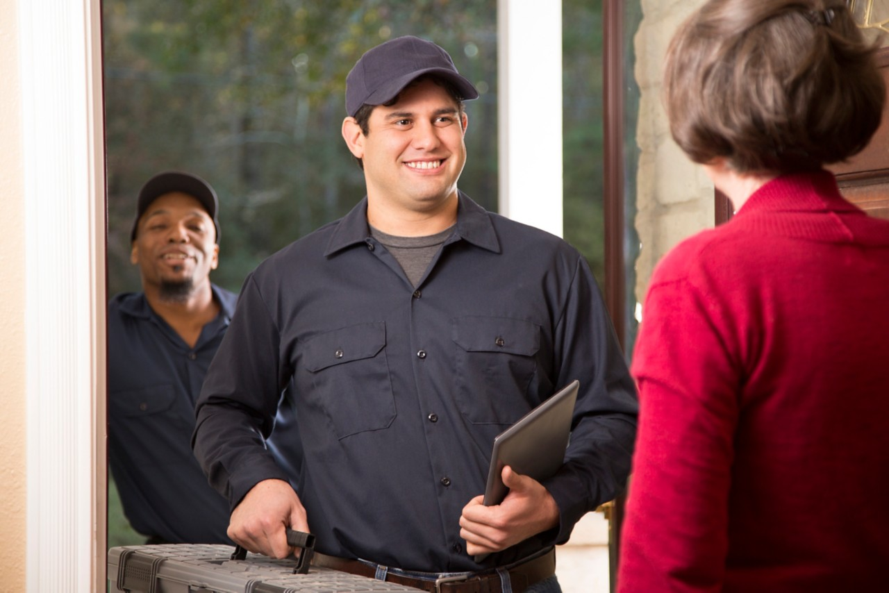 repairmen-arrive-at-female-customer's-home-with-tools-and-a-tablet-horizontal-5760x3840-image-file-913069734
