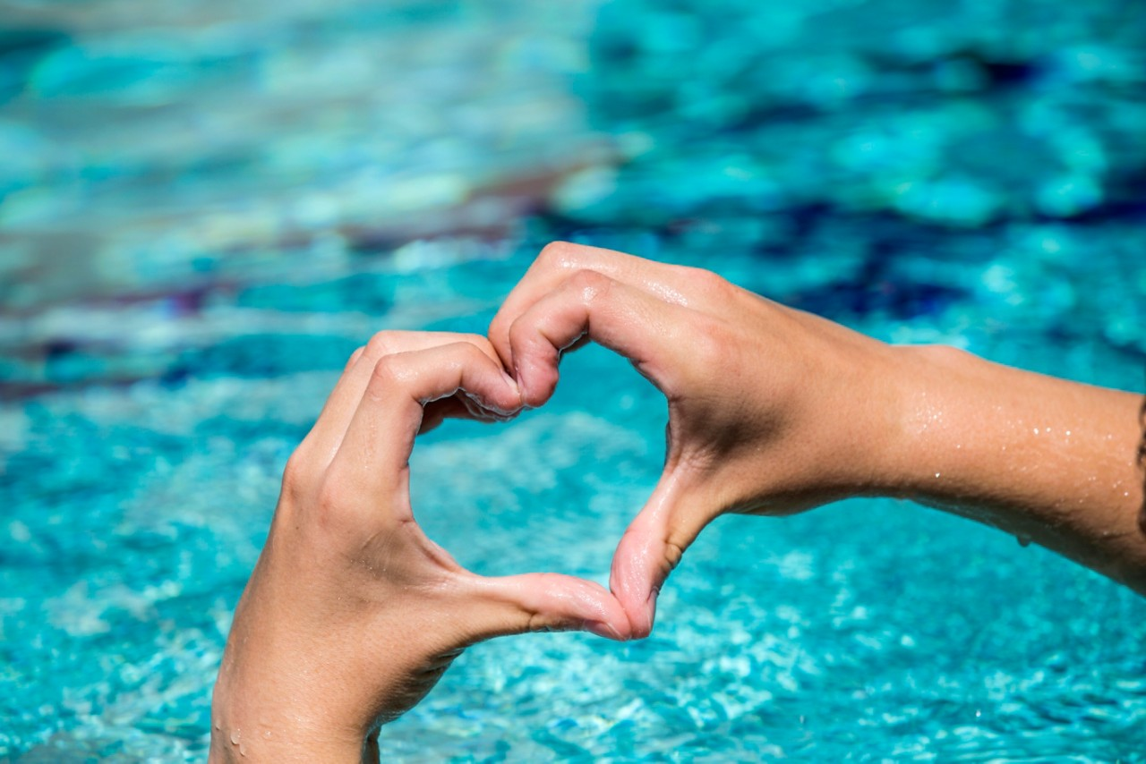 heart hands over pool