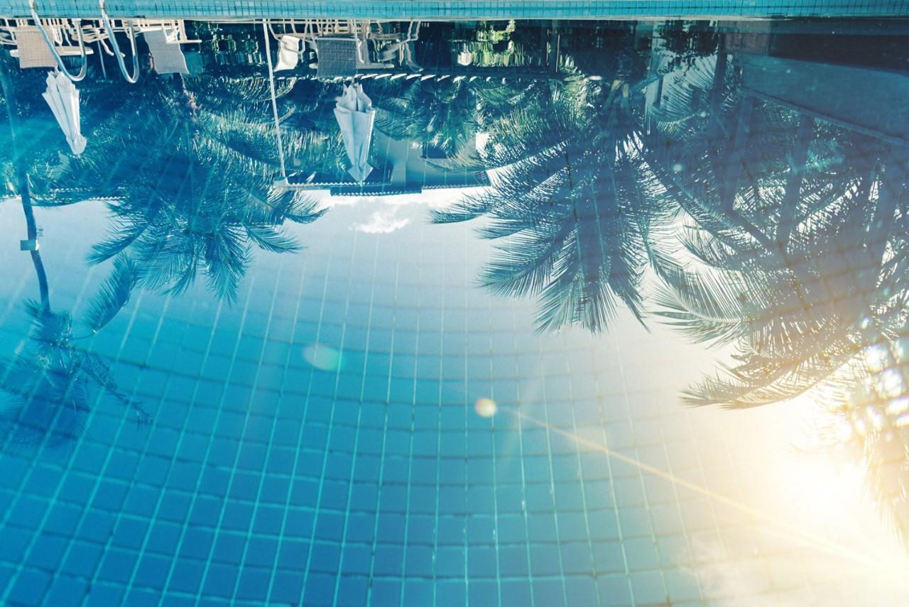 sun reflecting in pool
