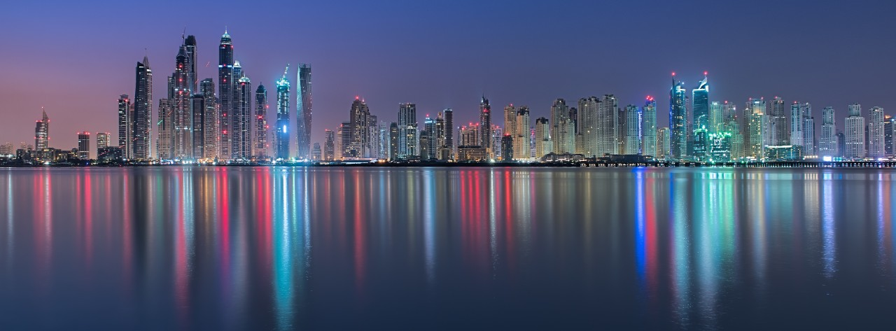 marina-city-skyline-panoramic-at-night-with-tall-buildings-and-colorful-lights-horizontal-7745x2867-image-file